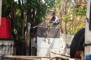 إزالة الإشغالات غير النظامية على الأرصفة والطرقات بمنطقة البرامكة