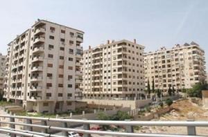 الإسكان تسلم دفاتر الإكتتاب في مشروع الادخار السكني بضاحية الفيحاء
