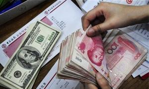 اليوان الصيني يسجل مستوى قياسيا مرتفعا جديدا امام الدولار الامريكي