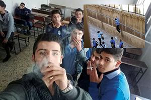 على مرأى الإدارة: طلاب هاربون من مدارسهم يدخنون مقابل باب المدرسة!