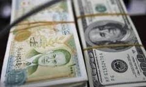 الدولار يتراجع في سورية بعد إعلان