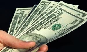 تجار: توقعات برفع المركزي لسقف مشتريات المواطنين السوريين للدولار لغير الأغراض التجارية