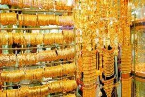 الدولار يدفع بالذهب نزولاً