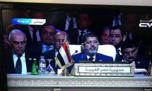 صورة مرسي والوفد المصري النائم في قمة الدوحة تثير سخرية مواقع أوروبية