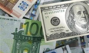 تراجع الدولار عالمياً  الى أدنى مستوى له في 14 شهرا أمام اليورو