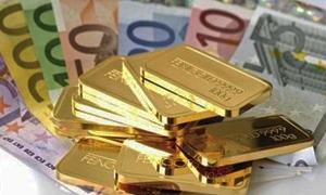 الذهب يتراجع عن أعلى مستوياته في ستة أشهر واليورو يتجاوز 1.2800 دولار للمرة الأولى
