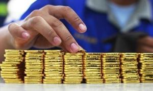 الذهب العالمي يتراجع عن مستوى 1200 دولار للمرة الاولى في حوالي 3 سنوات