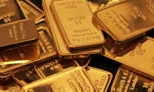 الذهب يواصل التراجع مع هبوط أسعار النفط..والأوقية عند 1185.10 دولار