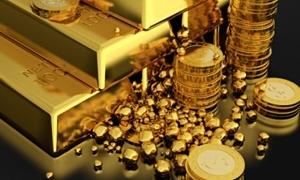 مسح يرجح استمرار تراجع الذهب في  2014 لأقل من 1300 دولار