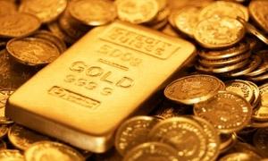 الذهب العالمي يهبط حوالي 1% لكنه ينهي الاسبوع الخامس على التوالي من المكاسب