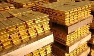 الذهب يرتفع مع هبوط الدولار والأسهم..و الأوقية عند 1075.10 دولاراً