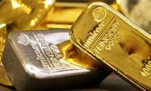 الذهب يهوي لأدنى مستوى في 5 أعوام دون 1100 دولار للأوقية