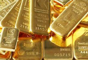 الذهب يتراجع مع تماسك الدولار ويتحرك في نطاق ضيق .. والأونصة عند 1320.79 دولاراً