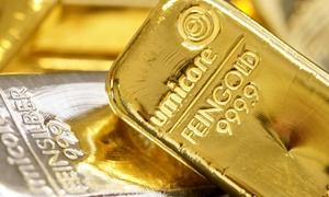 الذهب يحوم حول 1590 دولارا متجها لثاني أسبوع من المكاسب