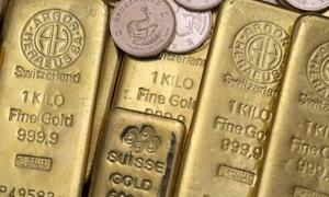 الذهب قرب أدنى مستوى في 3 أسابيع بفعل توقعات رفع الفائدة الأميركية