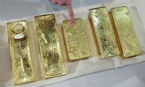 الذهب يهبط دون 1500دولار للأوقية للمرة الأولى منذ يوليو 2011