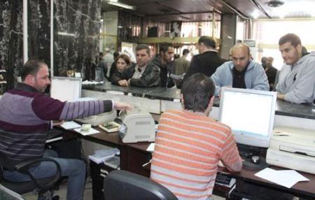 المصرف التجاري: عودة القروض للمواطنين مرهون بتحسن الظروف ..ولا فرض ضائعة للربح نتيجة توقف الإقراض
