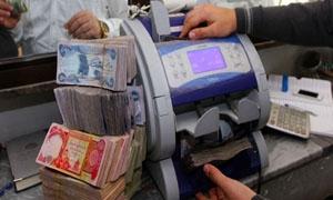 الدينار العراقي يهبط إلى أدنى مستوياته منذ 9 سنوات
