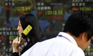 أسهم اليابان تغلق منخفضة والمستثمرون يرقبون المركزي الأمريكي