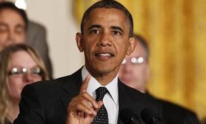 """أوباما: أميركا تدخل في 2014 عام """"الخرق"""" بعد أعوام من متاهة الأزمة الاقتصادية"""