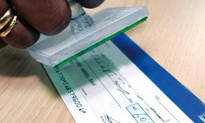 منعاً للتزوير.. المصرف العقاري يعمم على ارفاق البصمة مع التوقيع لصرف الشيكات