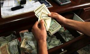 المركزي يحدد سعر دولار الحوالات بـ183.17 وشركات الصرافة بـ184.09