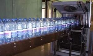 وزير الصناعة يكلف مديرا جديدا للشركة العامة لتعبئة المياه