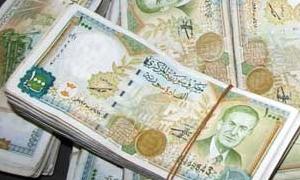 ضبط شخص في اللاذقيةحول بناء من ثلاثة طوابق إلى خزانة من العملات المختلفة