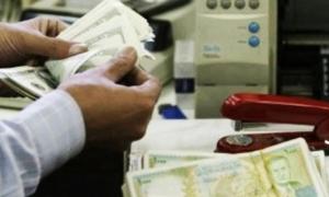 محلل مالي:اجراءات ضبط سعر دولار السوداء لم تخرج من نطاق