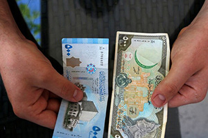 تحسن طفيف بقيمة الليرة السورية بعد ( اجتماع استثنائي ) في دمشق