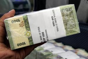 تقرير: ارتفاع سعر صرف الدولار مقابل الليرة السورية 1200 بالمئة خلال 5 سنوات.. والمركزي يرفع سعره 70% في عام