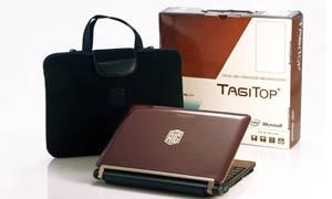 تاجي توب أول كمبيوتر محمول بعلامة تجارية عربية