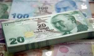 الليرة التركية تهبط إلي مستوى قياسي منخفض جديد أمام الدولار الامريكي