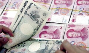 اليوان الصيني يهبط الي أدنى مستوى في 13 شهرا امام الدولار